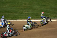 Speedway riders on the track Stock Photography