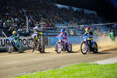 Speedway riders on the track. DAUGAVPILS, LATVIA - August 6, 2016: second round of Euro Speedway Championship. Speedway riders on the track royalty free stock photo