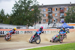 Speedway riders on the track. DAUGAVPILS, LATVIA - August 6, 2016: second round of Euro Speedway Championship. Speedway riders on the track royalty free stock photography