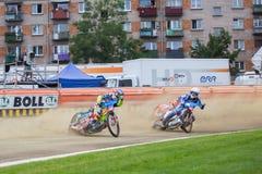 Speedway riders on the track. DAUGAVPILS, LATVIA - August 6, 2016: second round of Euro Speedway Championship. Speedway riders on the track stock images