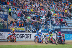 Speedway riders on the track. DAUGAVPILS, LATVIA - August 6, 2016: second round of Euro Speedway Championship. Speedway riders on the track stock image