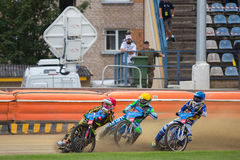 Speedway riders on the track. DAUGAVPILS, LATVIA - August 6, 2016: second round of Euro Speedway Championship. Speedway riders on the track royalty free stock images