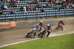 Speedway riders on the track. DAUGAVPILS, LATVIA - July 17, 2016. Speedway riders on the track. Semifinal of Team Speedway Junior European Championship royalty free stock images