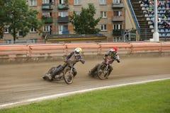 Speedway riders on the track. DAUGAVPILS, LATVIA - July 17, 2016. Speedway riders on the track. Semifinal of Team Speedway Junior European Championship royalty free stock image