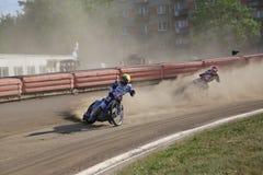 Speedway riders on the track. DAUGAVPILS, LATVIA - June 5, 2016: Speedway riders on the track in match of polish NICE league Lokomotiv - Orel 42:47 stock photography