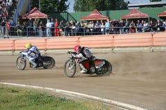 Speedway riders on the track. DAUGAVPILS, LATVIA - June 5, 2016: Speedway riders on the track in match of polish NICE league Lokomotiv - Orel 42:47 royalty free stock photos