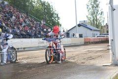 Speedway riders on the track. DAUGAVPILS, LATVIA - June 5, 2016: Speedway riders on the track in match of polish NICE league Lokomotiv - Orel 42:47 royalty free stock images