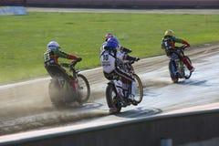 Speedway riders on the track. DAUGAVPILS, LATVIA - June 26, 2016: Speedway riders on the track in match of polish NICE league Lokomotiv - Polonia (Pila) 51:39 stock images