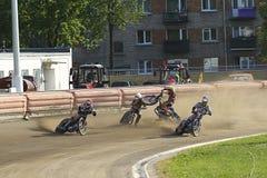 Speedway riders on the track. DAUGAVPILS, LATVIA - June 26, 2016: Speedway riders on the track in match of polish NICE league Lokomotiv - Polonia (Pila) 51:39 stock photo