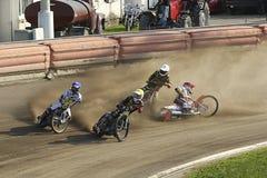 Speedway riders on the track. DAUGAVPILS, LATVIA - June 26, 2016: Speedway riders on the track in match of polish NICE league Lokomotiv - Polonia (Pila) 51:39 stock photography