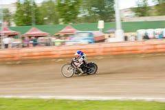 Speedway riders on the track. DAUGAVPILS, LATVIA - May 22, 2016: Speedway riders on the track in match of polish NICE league Lokomotiv - Wlokniarz Czestochowa 51 stock image