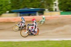 Speedway riders on the track. DAUGAVPILS, LATVIA - May 22, 2016: Speedway riders on the track in match of polish NICE league Lokomotiv - Wlokniarz Czestochowa 51 royalty free stock image