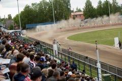 Speedway riders on the track. DAUGAVPILS, LATVIA - Vfy 22, 2016: Speedway riders on the track in match of polish NICE league Lokomotiv - Wlokniarz Czestochowa 51 royalty free stock photography