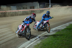 Speedway riders on the track - Joonas Kylmaekorpi ahead, Maksim Bogdanov next Stock Images