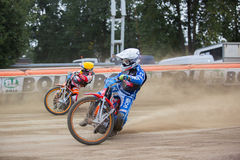 Speedway riders on the track - Maksim Bogdanov ahead Stock Photography