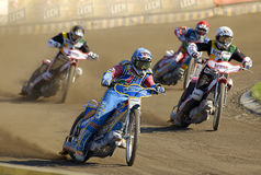 Speedway riders on the track in Poznan Stock Photo