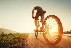Speedy bicyclist on a sunny afternoon Stock Photo