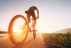 Speedy bicyclist on a sunny afternoon Royalty Free Stock Images