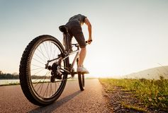 Speedy bicyclist wide angle shoot stock images