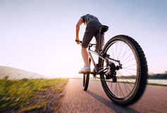 Speedy bicyclist wide angle wheel view Royalty Free Stock Photography