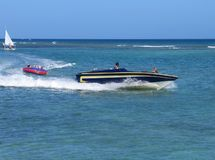 Speedy boat. With kids enjoying outdoor sports. Colours unaltered stock image