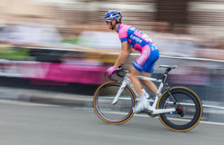 Speedy Cycling. Saint Quentin, France, July 5th 2012:Panning image of a cyclist from Lampre ISD team sprinting in the last 450 meters before finish line in Saint Stock Images