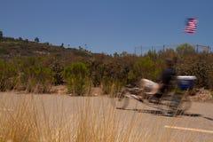 Speedy Cyclist. A speedy cyclist cruises near a lake stock photos