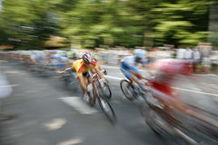 Speedy cyclists. The cyclists riding by at the bicycle race Around Denmark royalty free stock image
