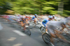 Speedy cyclists. The cyclists riding by at the bicycle race Around Denmark stock image