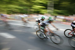 Speedy cyclists. The cyclists riding by at the bicycle race Around Denmark royalty free stock images