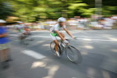 Speedy cyclists. The cyclists riding by at the bicycle race Around Denmark Royalty Free Stock Photo