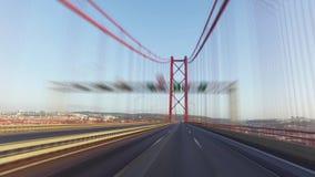 Speedy Driving on a 25 de Abril Bridge in Lisbon stock video footage