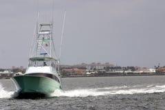 Speedy Fishing boat Yacht. A yacht fishing boat speeds up the intercoastal Stock Image