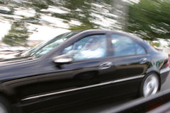 Speedy luxury ride on the move. Motion blurs Royalty Free Stock Photography