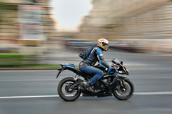 Speedy motor. Man ride a speedy motor in Budapest at main street royalty free stock images