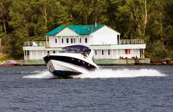 Speedy motorboat. Surfing the river Royalty Free Stock Image
