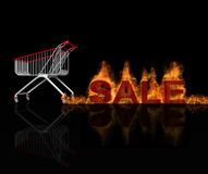 The speedy moving shopping cart, leaving the fire. Burning trace off the wheels with hot sale title, flame burning effect and reflection Royalty Free Stock Photography