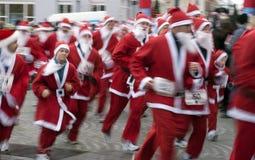 Speedy Santa Claus all over Royalty Free Stock Photo
