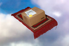 Speedy, secure  delivery. When it positively, absolutely has to be there on time...send it air mail by magic carpet...with fringe whipping in the breeze as it Royalty Free Stock Photos