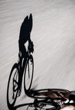 Speedy shadow. Bicycle racing down the road at a triathlon Stock Images