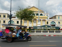 Speedy tricycle pass Ministry of Defence in Bangkok Royalty Free Stock Image