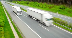 Speedy Trucks. Motion blurred trucks on highway Stock Photos