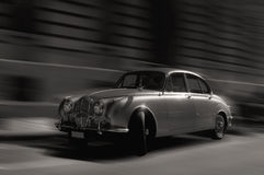 Speedy british vintage car monotone. Speedy vintage car black and white monotone antique old timer automotive classic collector motion dynamic energy time warp Royalty Free Stock Image