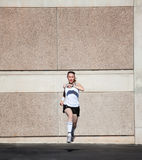 Speedy woman runs for fun. Royalty Free Stock Images