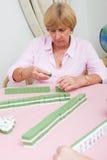 Speel mahjong spel Royalty-vrije Stock Afbeeldingen