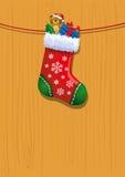 Speelgoed in de kous van Kerstmis Stock Foto