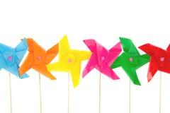 Speelgoed van een rij het kleurrijke miniatuurwindmils Stock Foto