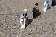 Speelgoed van Westelijke Mensen op Paarden stock foto