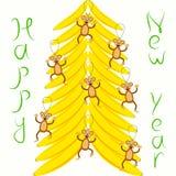 Speelgoedaap het hangen op een banaanboom Royalty-vrije Stock Fotografie