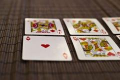 Speelkaarten in een rij Stock Fotografie